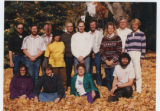 Photo of Willy Burgdorfer with large group outdoors.  Photo is labeled on back, 'Rocky Mountain...