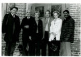 Photo of Willy Burgdorfer with three men and two women outside brick building