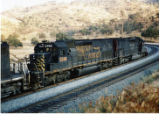 Southern Pacific locomotive No. 5366 providing pulling power for the Oil Can train near Tehachapi,...