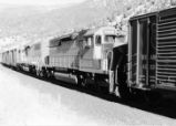 Utah Railway locomotive No. 9008 working as a mid-train helper.