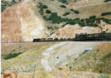 Train of military vehicles descends from the tunnels at Billie's Mountain.