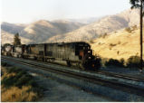 Southern Pacific 8258 providing pulling power for the Oil Can train near Tehachapi, California