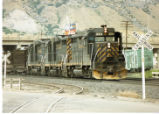 Denver and Rio Grande Western local led by Engine No. 3004 pulling out of rail yard, Provo, Utah.