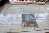 Step 05: Outlines of the panels were traced on to large sheets of clear glass.