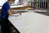 Step 04: Martha Denzer peels the pattern off a vinyl sticker layout sheet on which the template...