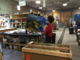 Step 06: Daniel Bradford unloads a new sheet of raw glass