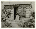 Mary Ann Wastel Williams in Front of Cabin