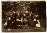Thirteen Women Posed Outdoors