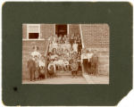 School Class of young children on Steps of Brick Building