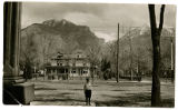 Post card of boy, house and mountains in Provo, Utah