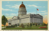 Postcard of Utah State Capitol Building in Salt Lake City, Utah, with trees and flowers.