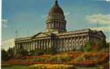 Color postcard of Utah State Capitol Building and flower beds, in Salt Lake City, Utah.